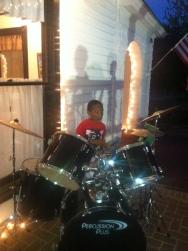 2nd grader on drums